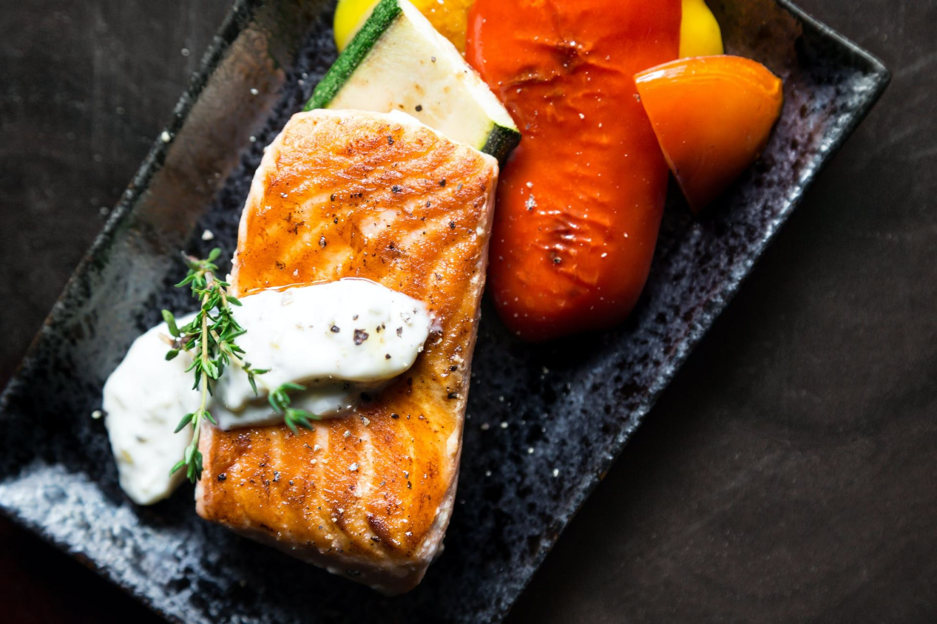 salmon on a plate with veg