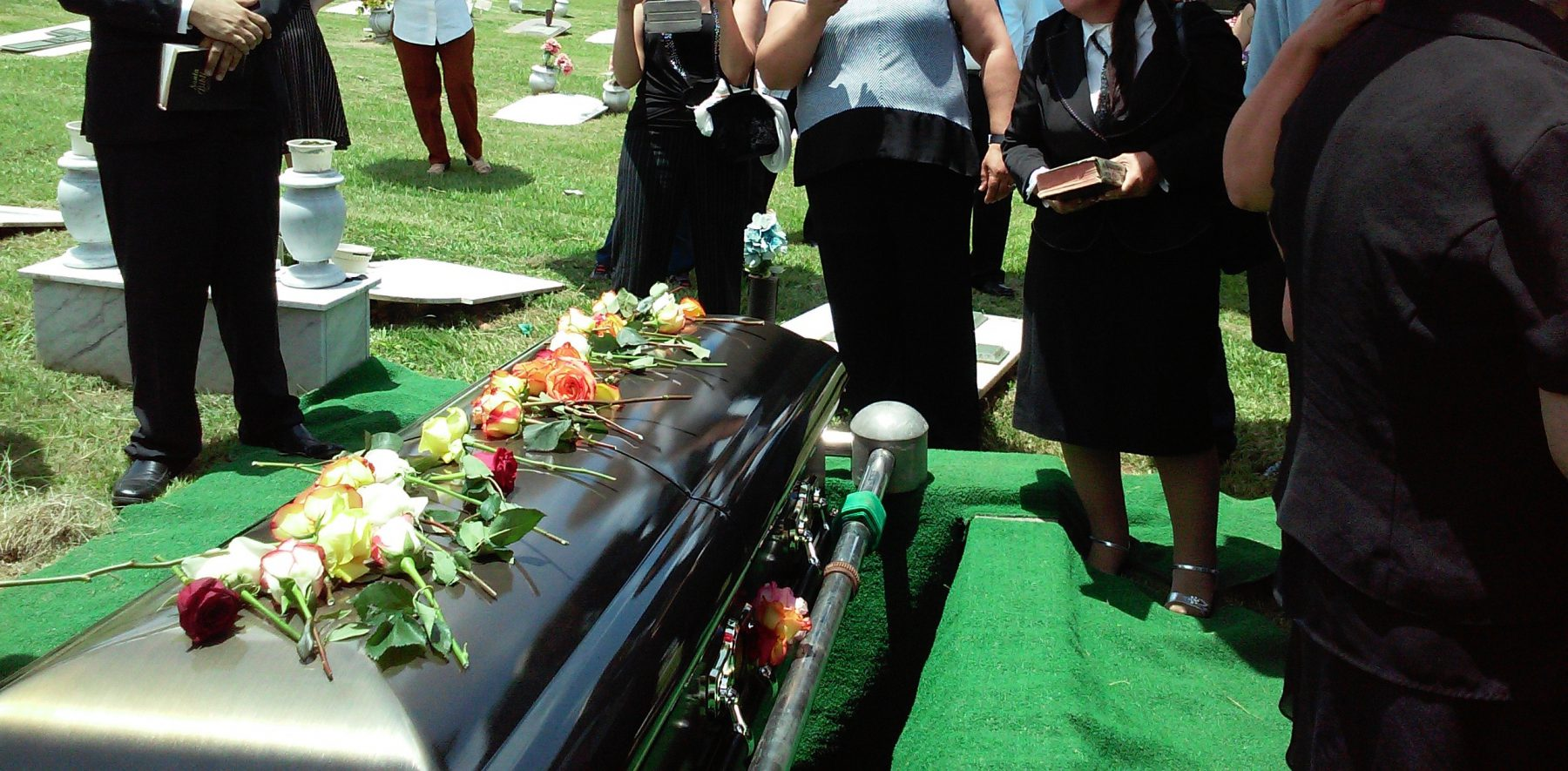 People at burial funeral