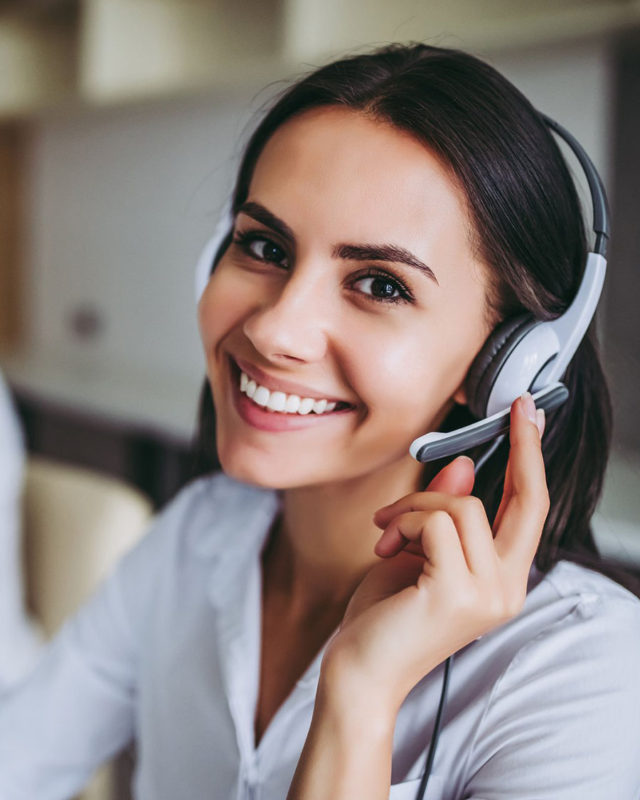 smiling woman wearing headset
