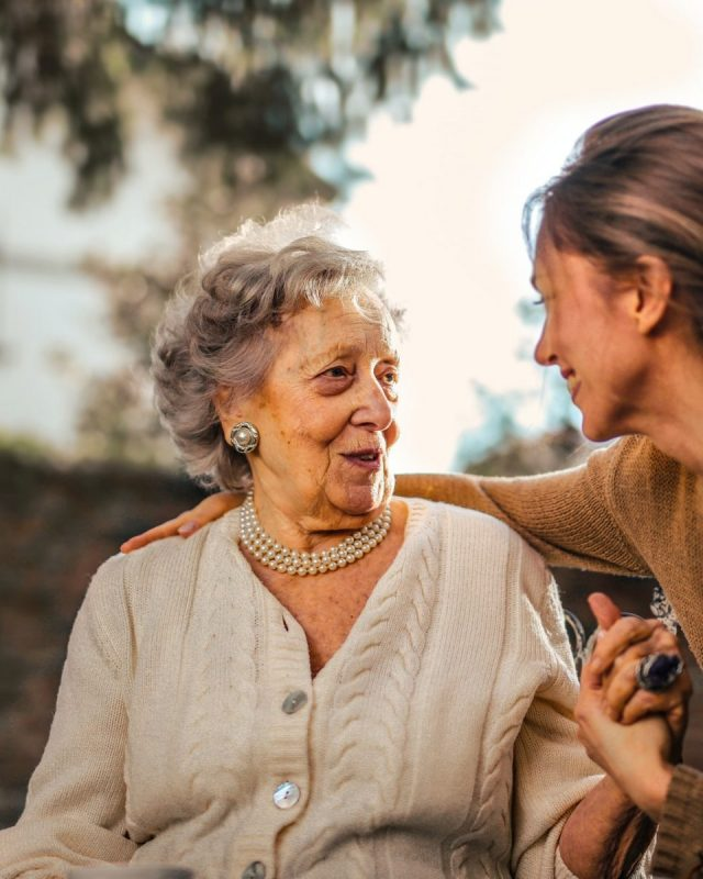 Happy old woman with her daughter