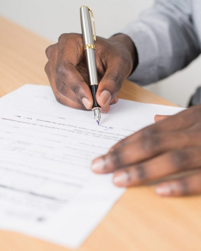 A man signing a will