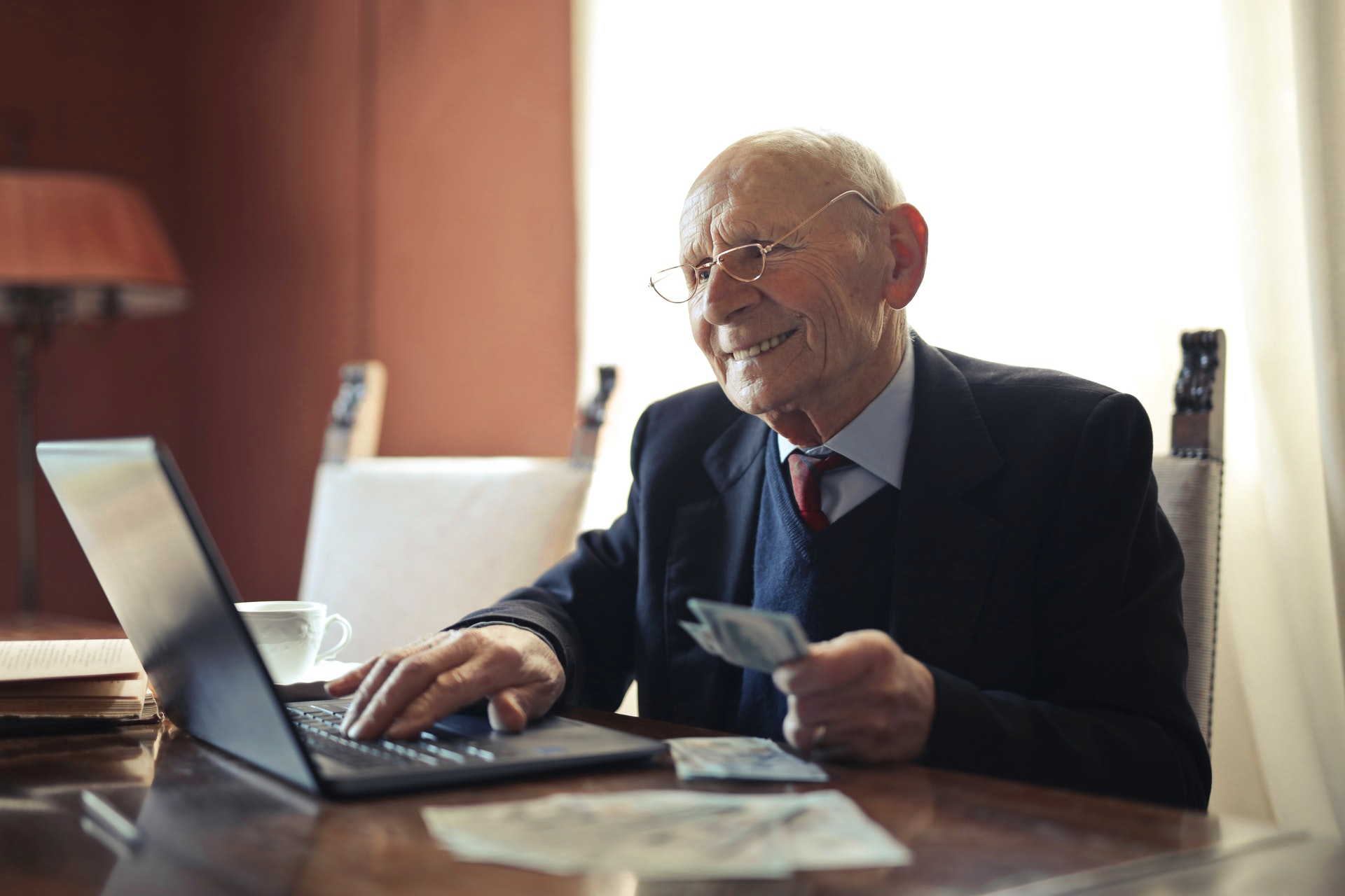 elderly man paying online